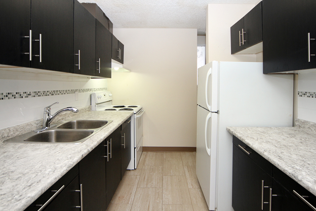 3 bedroom Apartments for rent in Calgary at Queens Park Village - Photo 07 - RentersPages – L395695